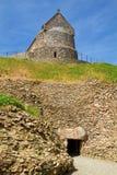La Hougue Bie, Jersey, UK. Entrance to the megalithic tomb of La Hougue Bie with Chapel, Jersey, UK Stock Photos