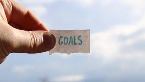 La idea de las metas, etiqueta con la inscripción, empañó la foto para el fondo metrajes