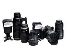 La idea de un fotógrafo profesional con los accesorios blancos del fondo Imágenes de archivo libres de regalías