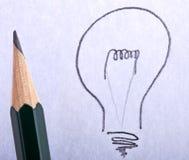 La idea grande, bombilla con la pluma Foto de archivo