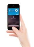 La identificación Apple del tacto paga tecnología en el iPhone gris 5S del espacio de Apple en f Fotografía de archivo libre de regalías