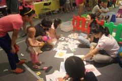 La identificación de la competencia de la imagen en el SHENZHEN Tai Koo Shing Commercial Center Imágenes de archivo libres de regalías