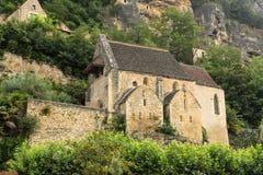 La iglesia en el La Roque-Gageac Imagen de archivo