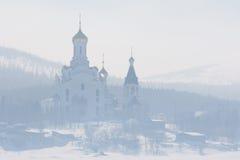 La iglesia en la niebla Fotografía de archivo libre de regalías