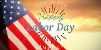 La imagen compuesta de la imagen compuesta digital del Día del Trabajo feliz y dios bendicen el texto de América foto de archivo libre de regalías