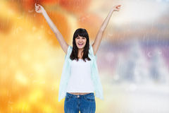 La imagen compuesta de la mujer emocionada con las manos aumentó en el fondo blanco Imagen de archivo