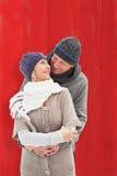 La imagen compuesta de pares maduros felices en invierno viste el abarcamiento Foto de archivo libre de regalías