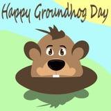 La imagen del groundhog que mira fuera del agujero y considera su sombra Imagenes de archivo