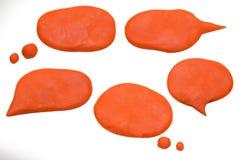 La imagen del playdough de la charla del globo en el fondo blanco Foto de archivo