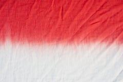la immersione del modello della tintura del legame ha tinto la tecnica sul fondo del tessuto di cotone Fotografia Stock