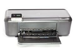 La impresora de chorro de tinta en un fondo blanco Foto de archivo