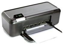 La impresora de chorro de tinta en un fondo blanco Fotos de archivo