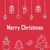 La inscripción de la Feliz Navidad en un fondo rojo con deco Foto de archivo