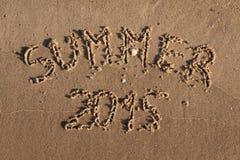 La inscripción en el verano de la arena Imágenes de archivo libres de regalías
