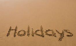 La inscripción en la arena - días de fiesta Fotos de archivo libres de regalías