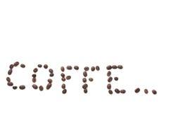 La inscripción se hace con los granos de café Foto de archivo libre de regalías