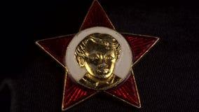 La insignia del Octobrist, símbolos soviéticos, promueve 4K almacen de metraje de vídeo