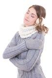 La jeune belle femme en hiver vêtx rêver d'isolement sur le whi Photographie stock libre de droits