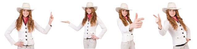 La jeune cow-girl visante d'isolement sur le blanc Image libre de droits