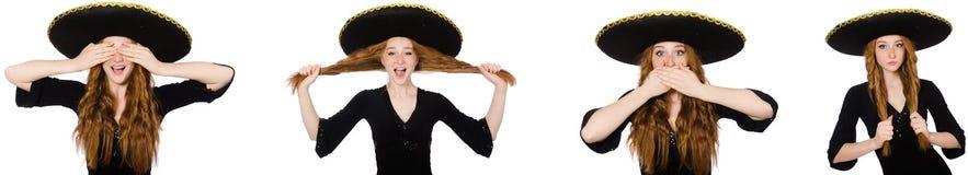 La jeune dame rousse dans la robe noire avec le sombrero noir photos libres de droits