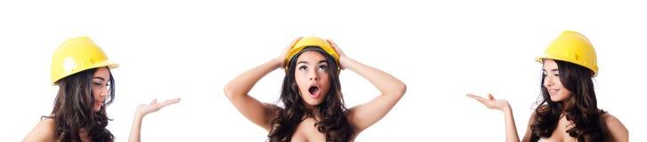 La jeune femme avec le casque antichoc jaune sur le blanc Images libres de droits