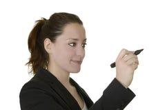 La jeune femme d'affaires écrit dans l'espace de copie libre Photos stock