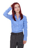 La jeune femme d'affaires confuse rayent sa tête Images libres de droits
