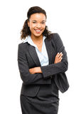 La jeune femme d'affaires de métis avec des bras a plié le sourire d'isolement Photos libres de droits