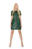 La jeune femme dans la robe verte d'isolement sur le blanc Images stock