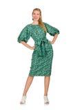 La jeune femme dans la robe verte d'isolement sur le blanc Photos stock