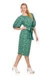 La jeune femme dans la robe verte d'isolement sur le blanc Images libres de droits