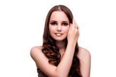 La jeune femme dans le concept de beauté sur le blanc a isolé le fond Photo libre de droits