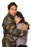 La jeune femme et le soldat dans l'uniforme militaire disent Photos stock
