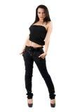 La jeune femme sexy dans jeans noirs photo libre de droits