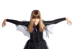 La jeune fille affiche 'bat' Photo stock