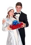La jeune fille de neige donne les présents pour Noël Photo stock