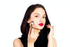 La jeune fille fait un maquillage Photographie stock
