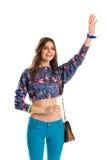 La jeune fille ondule sa main Photographie stock libre de droits