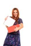 La jeune fille ouvre un cadre de cadeau Photos stock