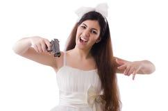La jeune jeune mariée dans le concept drôle sur le blanc Photo libre de droits