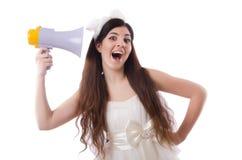 La jeune jeune mariée dans le concept drôle sur le blanc Photo stock