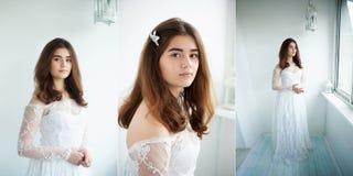 La jeune mariée sur un fond blanc dans une robe blanche de dentelle Belle beauté normale Maquillage léger et cheveux lâches norma Image libre de droits