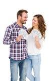 La jeune participation heureuse de couples a éventé des notes de devise image libre de droits