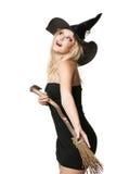 La jeune sorcière heureuse avec un balai Photo libre de droits