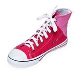 La jeunesse à la mode folâtre la chaussure sur le blanc Photos stock