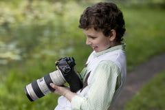La joie du jeune photographe Image stock