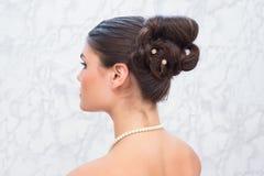 La jolie brune avec haut élégant font Photographie stock