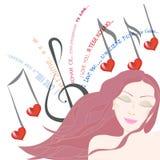 La jolie femme écoute des yeux de chanson d'amour fermés Photo stock