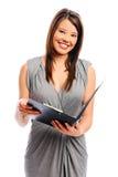 La jolie femme d'affaires retient un fichier photos libres de droits
