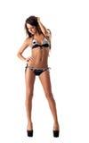 La jolie fille avec la peau saine fait de la publicité le maillot de bain Images stock